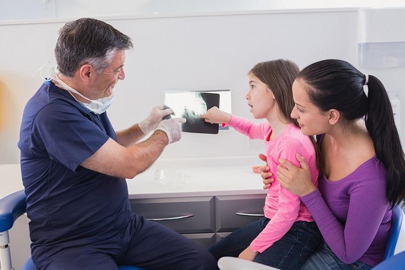 Pediatric dentist in Las Vegas explaining